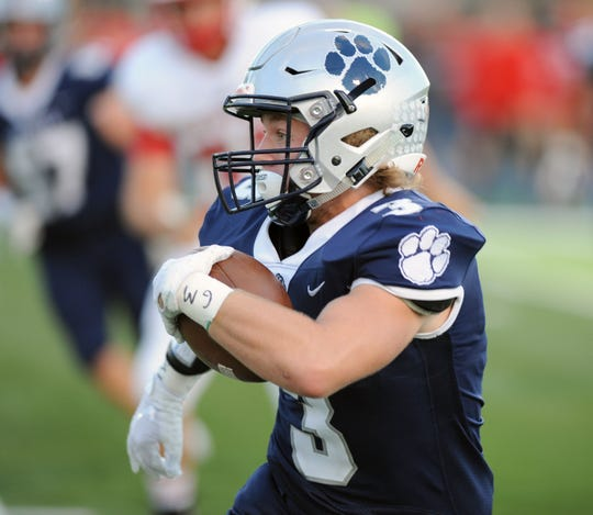 Macomb Dakota running back Dustin Solomon showed his versatility out of the backfield, rushing for 558 yards and seven scores while also catching 15 passes for 376 yards, including three TDs.