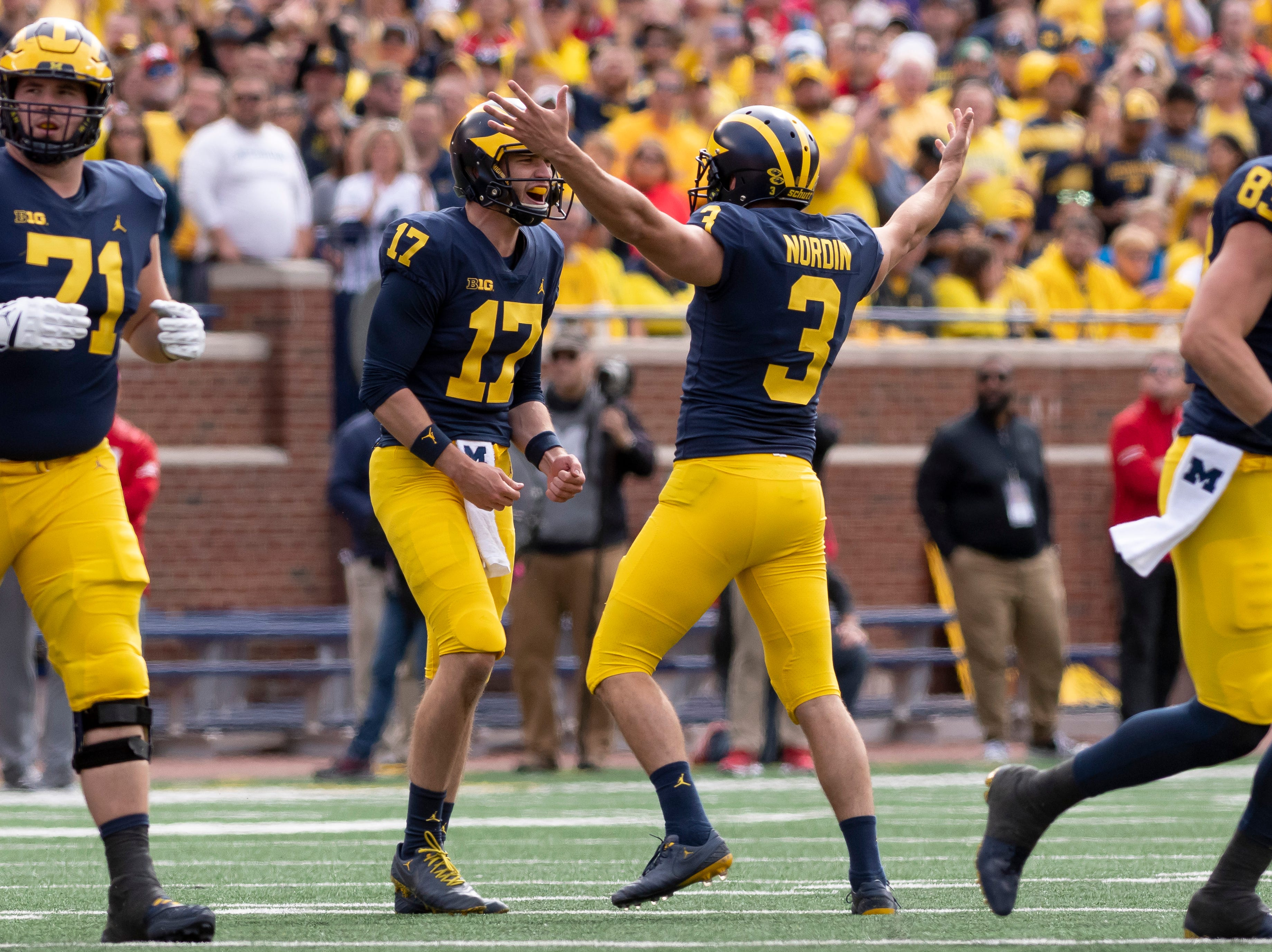 Michigan place kicker Quinn Nordin, right, celebrates with punter Will Hart after completing a 55 yard field goal in the second quarter.