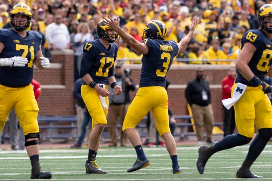 Michigan place kicker Quinn Nordin, right, celebrates with punter Will Hart after completing a 55-yard field goal Saturday.