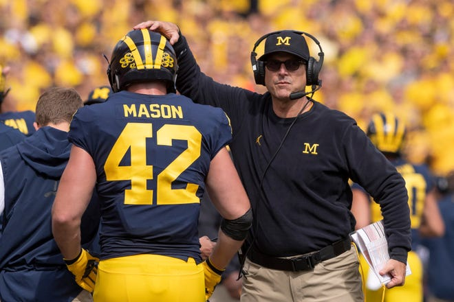 Michigan head coach Jim Harbaugh, right, fullback Ben Mason and the Wolverines are riding a three-game win streak into Saturday's matchup at Northwestern.