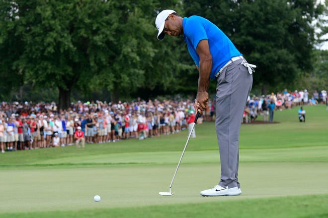 Tiger Woods putts for birdie on the third hole during the third round of the Tour Championship on Saturday.