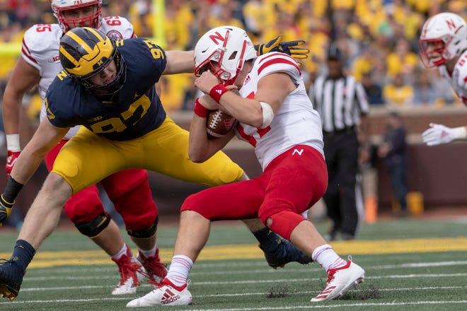 Michigan defensive lineman Aidan Hutchinson tackles Nebraska quarterback Andrew Bunch in the fourth quarter.