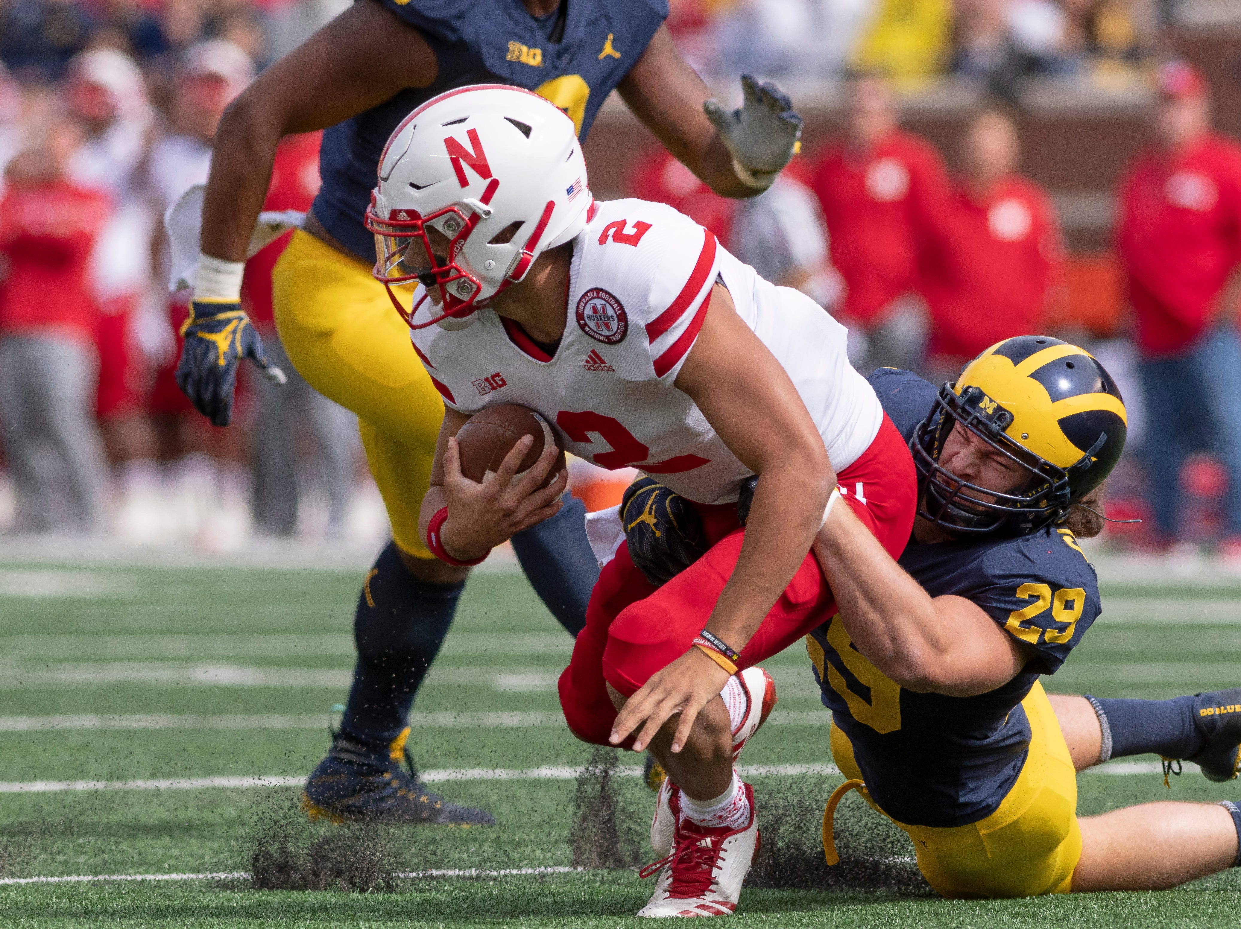 Nebraska quarterback Adrian Martinez is tackled by Michigan linebacker Jordan Glasgow in the first quarter.