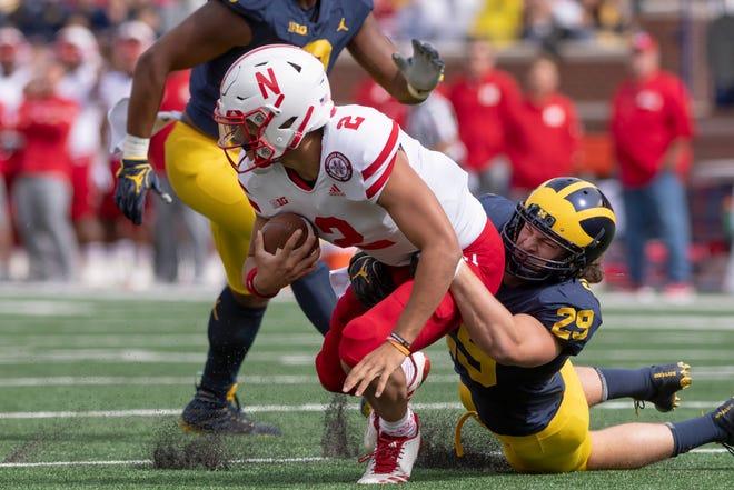 Nebraska quarterback Adrian Martinez is tackled by Michigan linebacker Jordan Glasgow in the first quarter of their game this season.