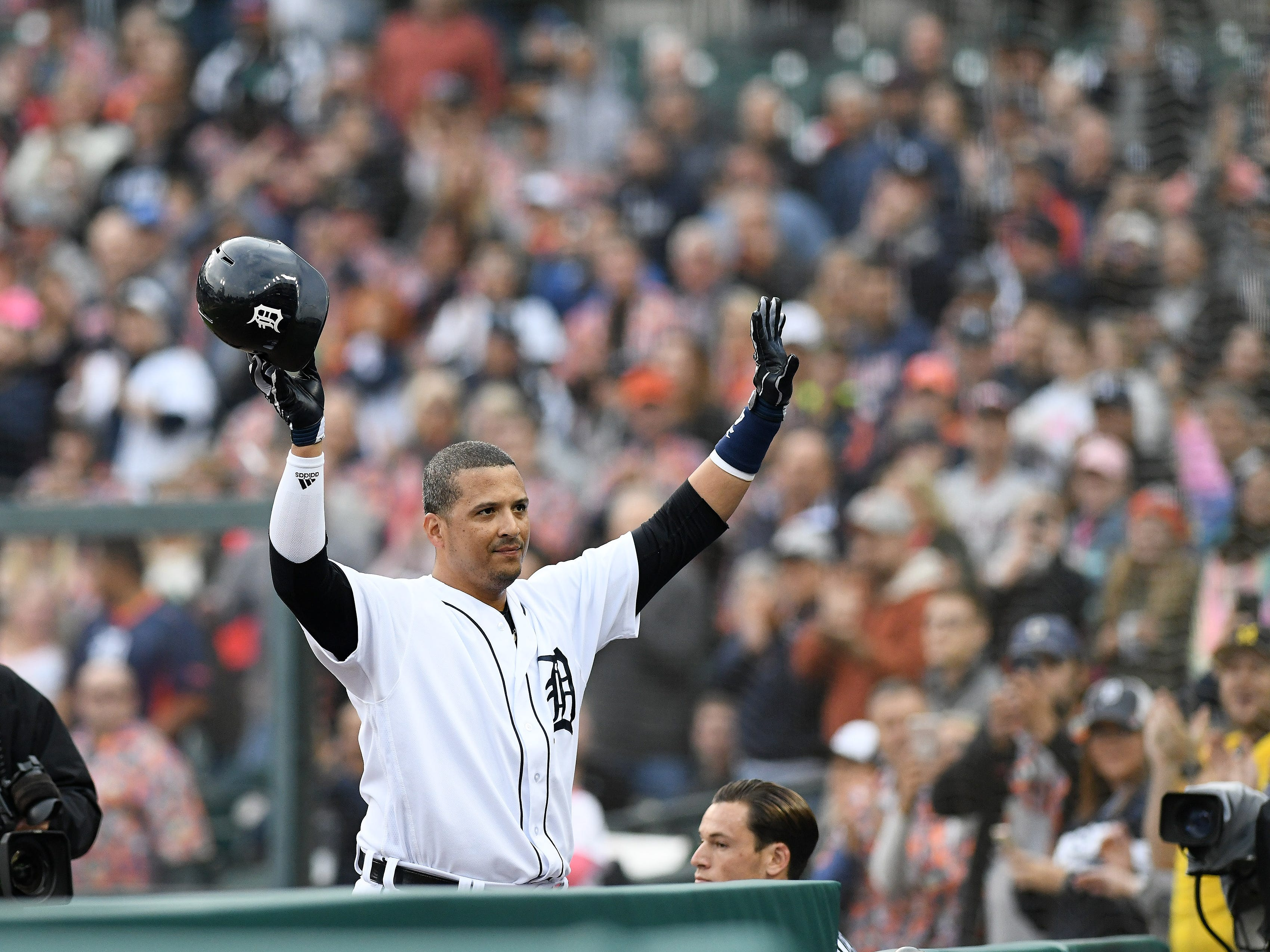 Tigers' Victor Martinez acknowledges the crowd as he comes out of the game after his final MLB hit.