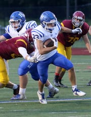 Riley Loomis breaks a tackle on his way to a long run for Horseheads in a 42-0 win over Ithaca on Sept. 21, 2018 at Ithaca High School.