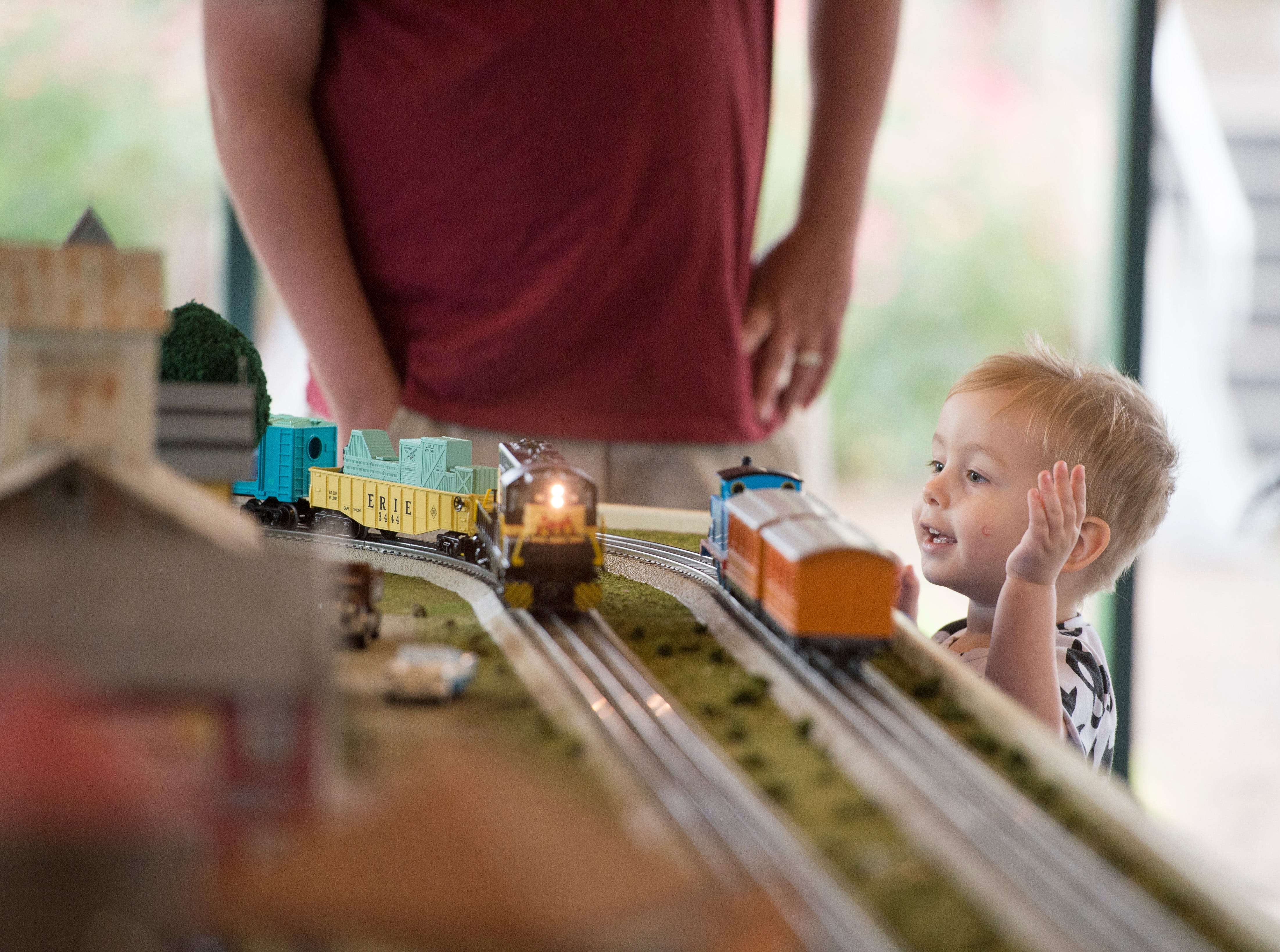 Josiah Cox, 2, gets excited as model trains go around the track during the Local Loco Model Railroad Club show at the Evansville Pagoda Sept. 22, 2018.