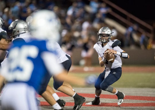 Reitz's Quarterback Eli Wiethop (1) looks for an open receiver during the Reitz vs Memorial game at Enlow field Friday Sept. 21, 2018. The Memorial Tigers won, 42-6.