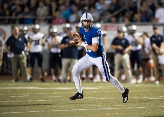 Memorial's Quarterback Michael Lindauer (11) looks for an open receiver during the Reitz vs Memorial game at Enlow field Friday Sept. 21, 2018. The Memorial Tigers won, 42-6.