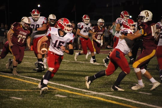 Cole Sigler runs during Heritage Hills' 31-7 over Gibson Southern on Friday night.