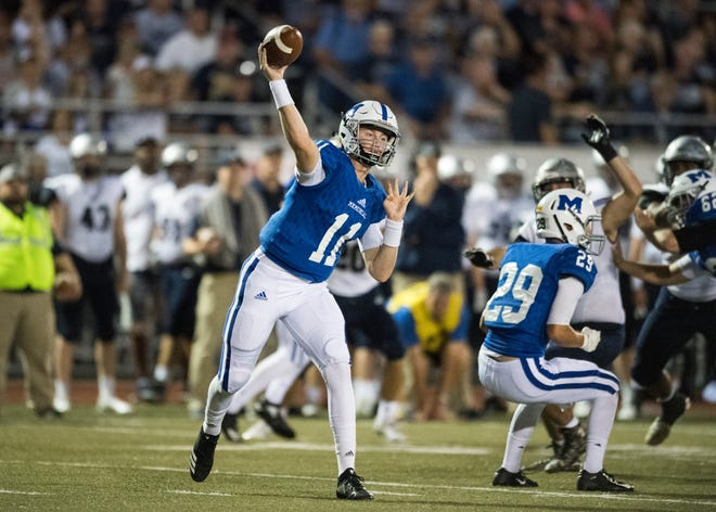 Michael Lindauer (11) was 21 of 24 passing for 276 yards and three touchdowns and ran for another score in Memorial's 42-6 win over Reitz Friday at Enlow Field.