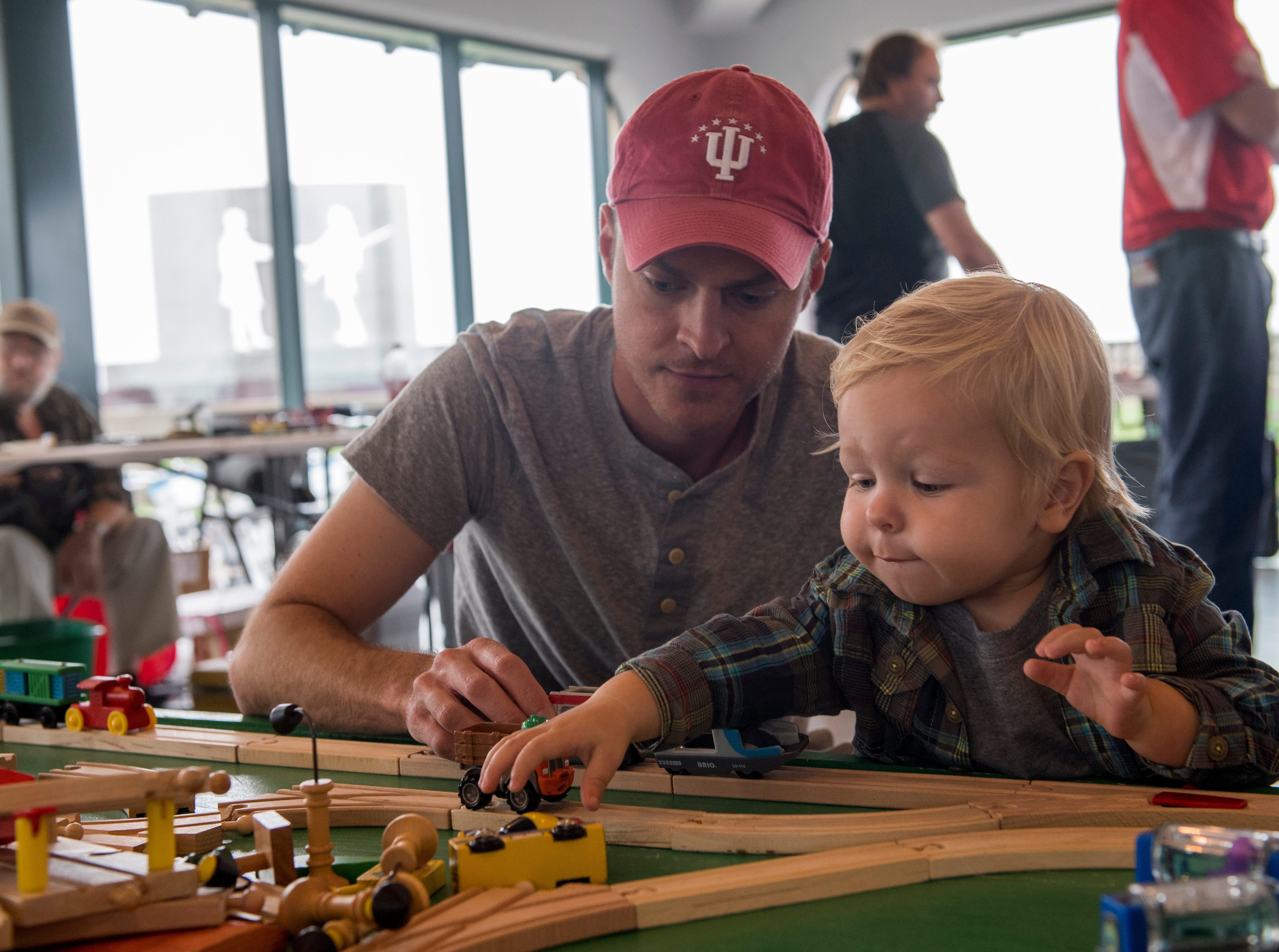 Brian and Luke Kuester spend the afternoon playing with trains during the Local Loco Model Railroad Club show at the Evansville Pagoda Sept. 22, 2018.