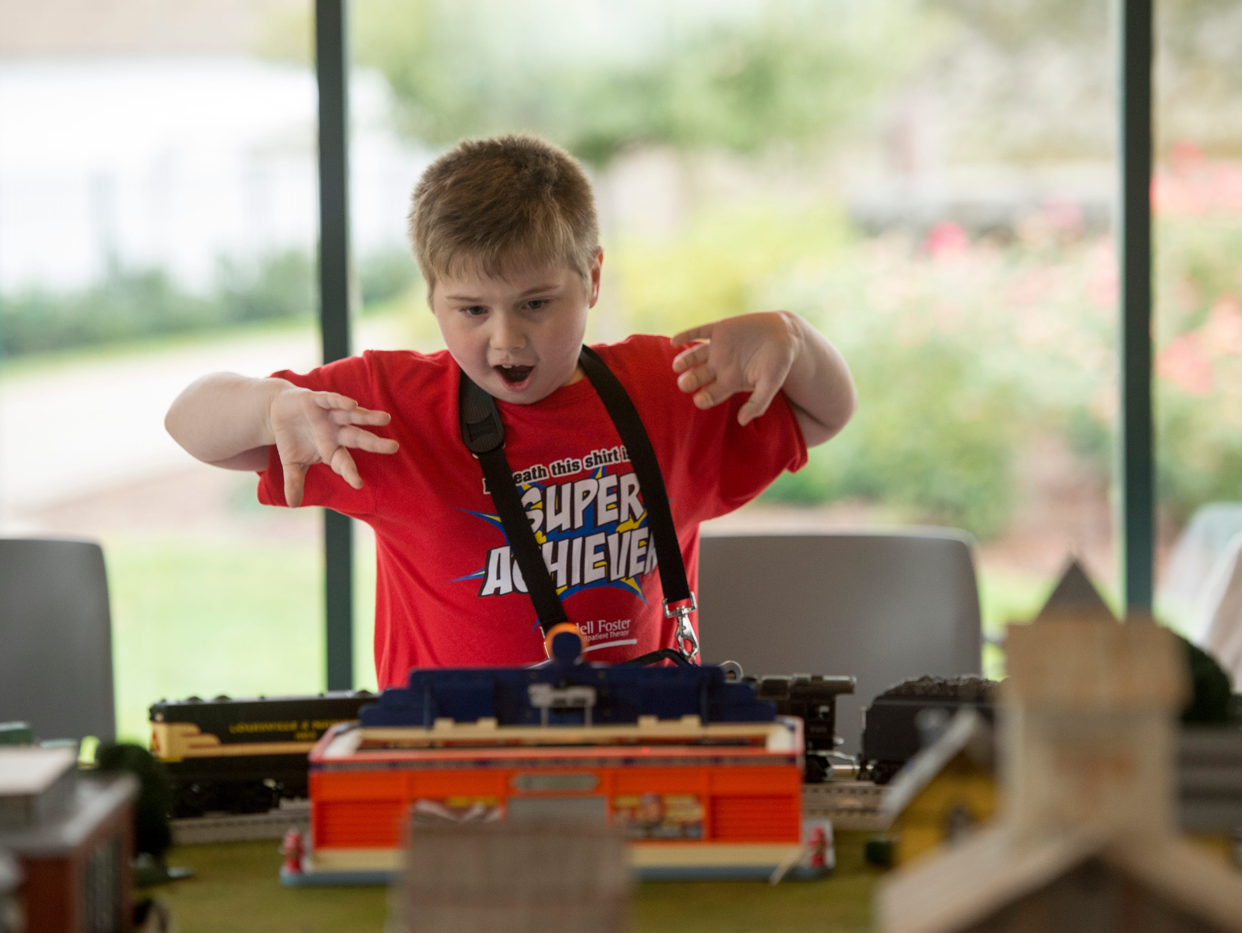 Jacob Cox, 7, gets excited as model trains go around the track during the Local Loco Model Railroad Club show at the Evansville Pagoda Sept. 22, 2018.