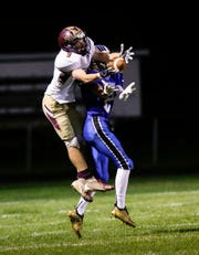 St. Mary's Springs' Matthew Moul breaks up a pass intended for Omro's Cooper Krockstrom on Friday.
