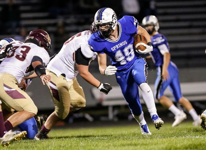 St. Mary's Springs' Jake Hoch runs the ball against Omro on Sept. 21. Springs received all 10 first-place votes in this week's poll in the Small Division.
