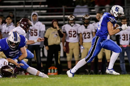 St. Mary's Springs' Jake Hoch breaks free and runs 56 yards for a touchdown against Omro on Friday.