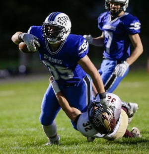 St. Mary's Springs' Marcus Orlandoni runs against Omro's Thomas Soda-Waters on Friday during their game at Fruth Field in Fond du Lac.