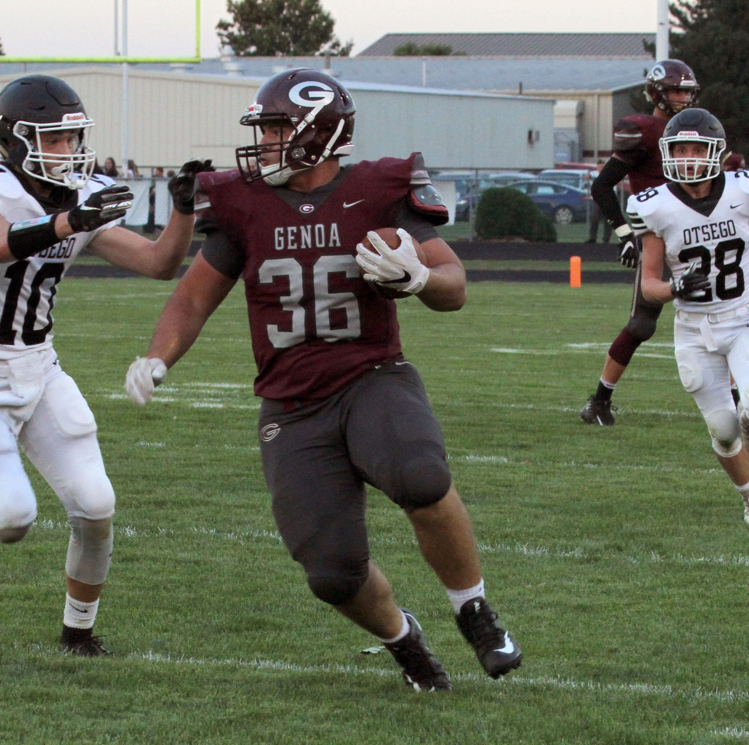 Genoa's Daniel Novotney carries the football against Otsego.