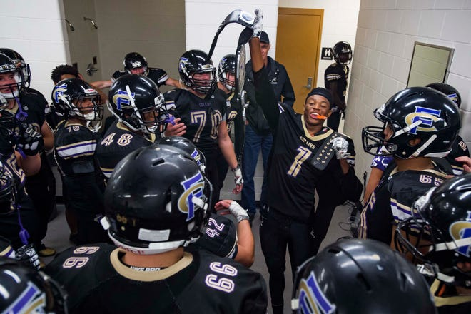 Fort Collins High School senior Micaylon Moore (1) hoists up a belt while celebrating with teammates after an overtime homecoming win over Poudre High School on Friday, Sept. 21, 2018, at French Field in Fort Collins, Colo.