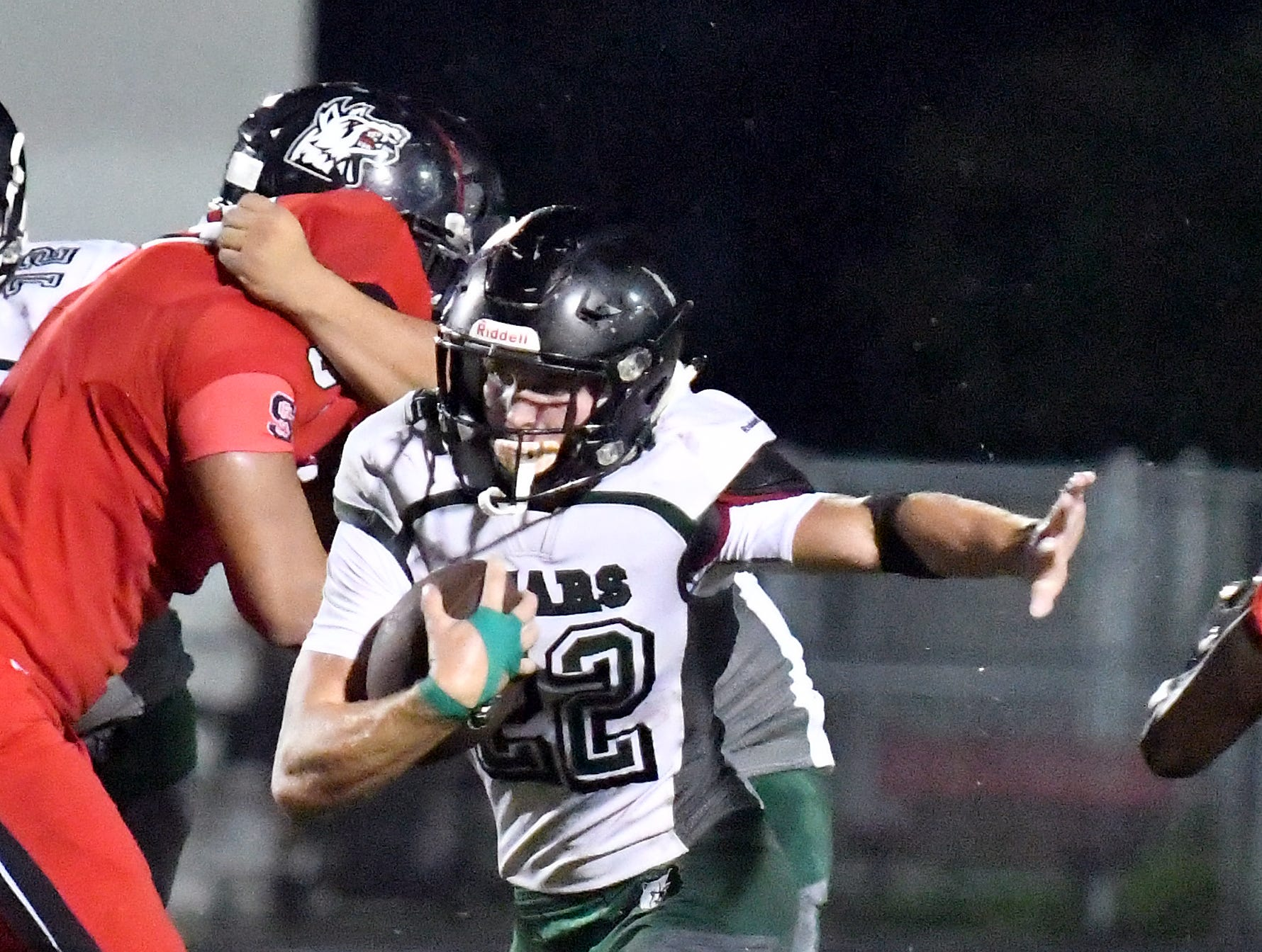 Palmetto Ridge High School Colby Singletary (22) find a hole to run the ball during their game with South Fort Myers High School in Fort Myers ,Friday, Sept. 21, 2018.