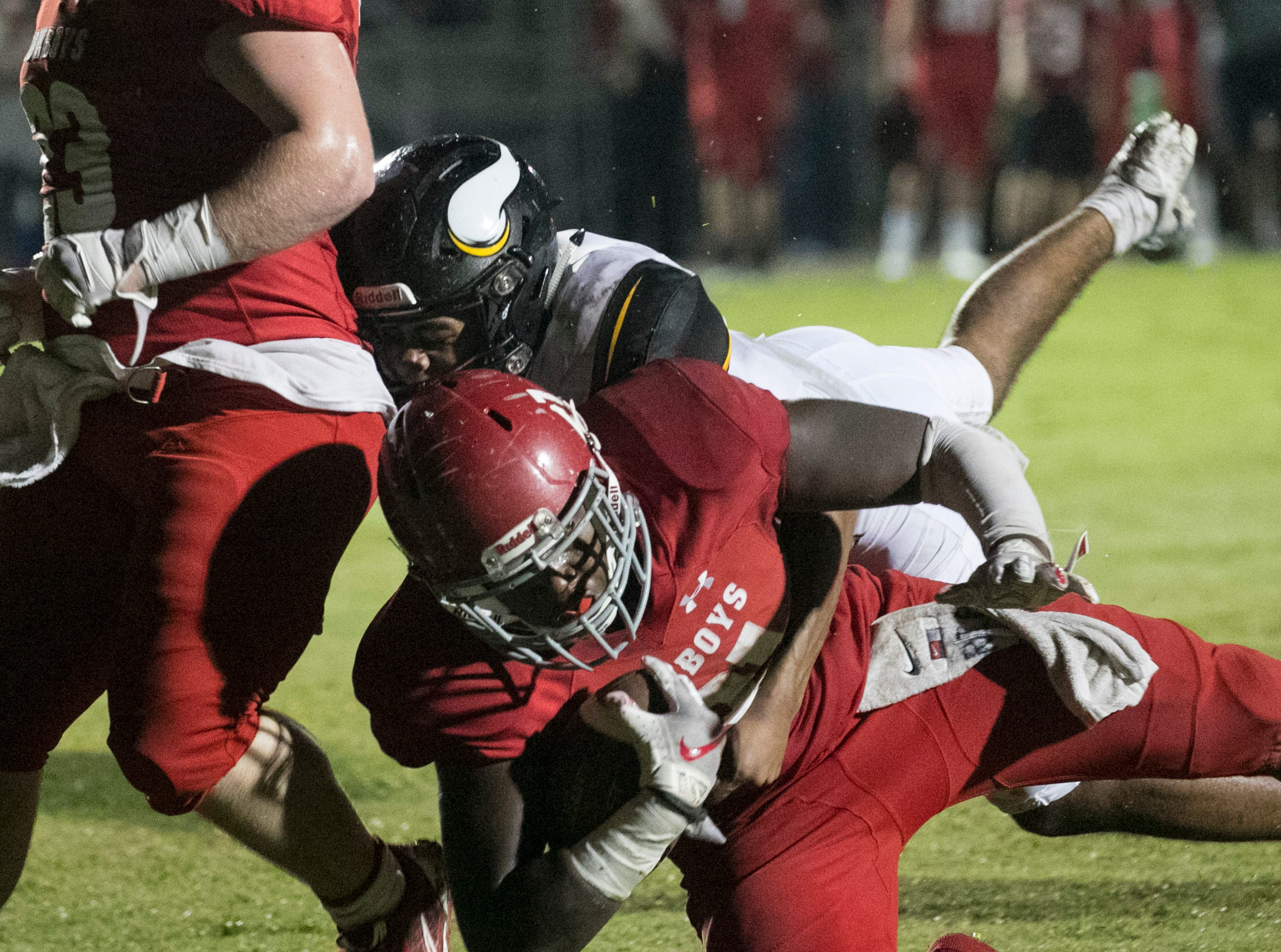 LaBelle's Maynard Blackmon is tackled in the endzone by Giancarlo Duplessy of Bishop Verot as he scores a touchdown in the first half on Friday night, Sept. 21, 2018, at LaBelle High School.