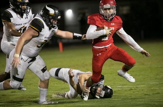 Enrique Hernandez of LaBelle slips away from Dylan Insolia of Bishop Verot on Friday night, Sept. 21, 2018, at LaBelle High School.