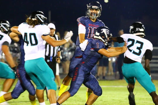 Estero quarterback Tanner Elliot Throws a touchdown pass against Gulf Coast.