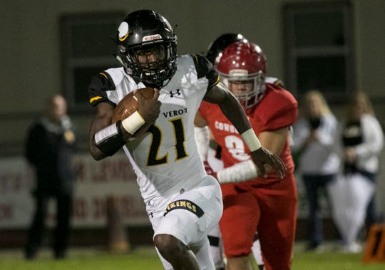 Terry Lindsey of Bishop Verot carries the ball against LaBelle on Friday, Sept. 21, 2018, at LaBelle High School.