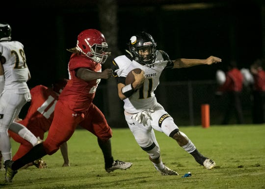 Bishop Verot's Jaidin Brown runs after making a catch against LaBelle on Friday night, Sept. 21, 2018, at LaBelle High School.