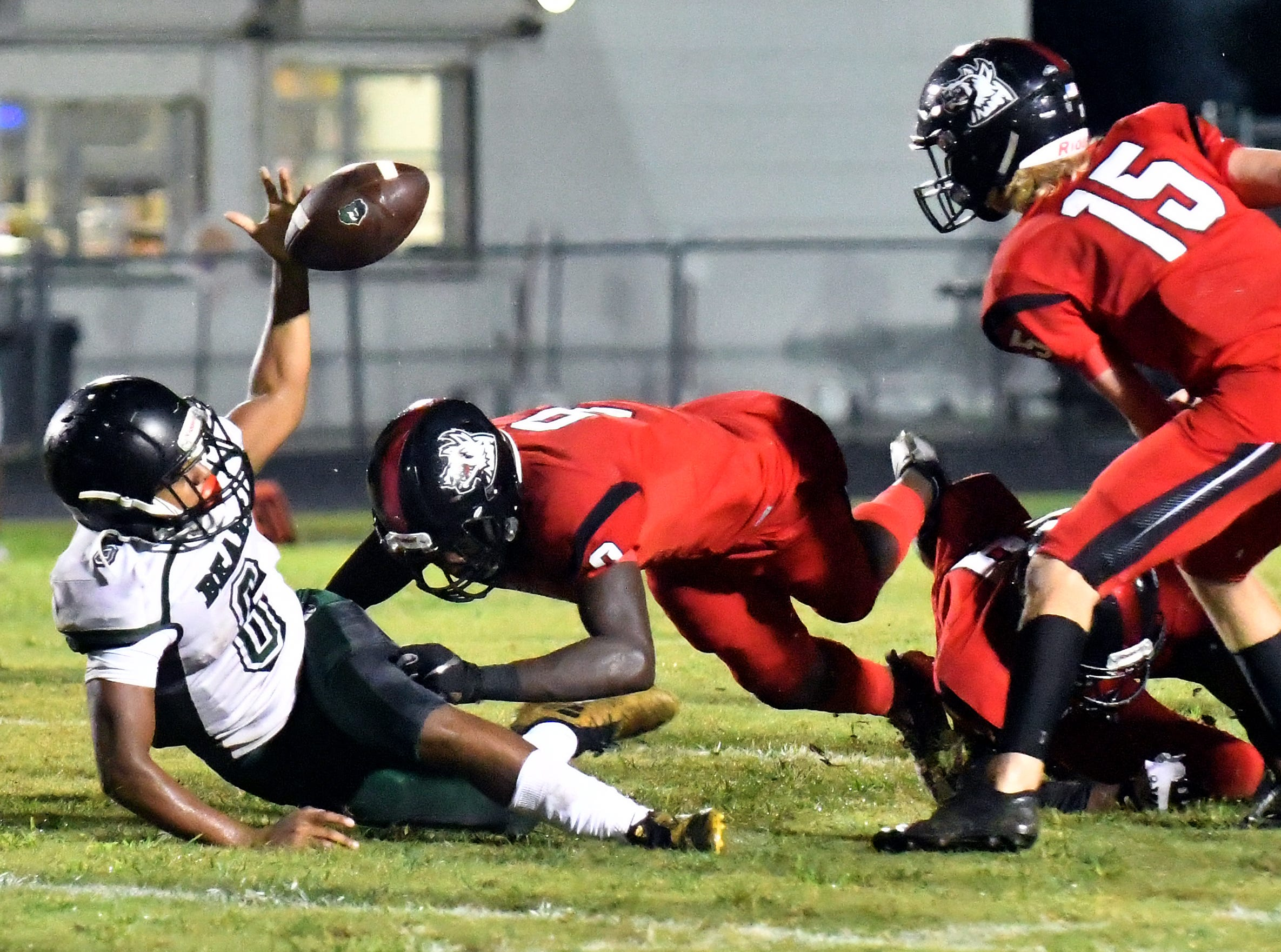 Palmetto Ridge High School Leonel Garza (6) tries to regain control of the ball on a forced fumble during their game with South Fort Myers High School in Fort Myers ,Friday, Sept. 21, 2018.