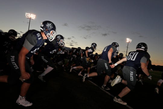 Bay Port players take the field to face Notre Dame in a high school football game at Bay Port High School on Friday, September 21, 2018 in Suamico, Wis.