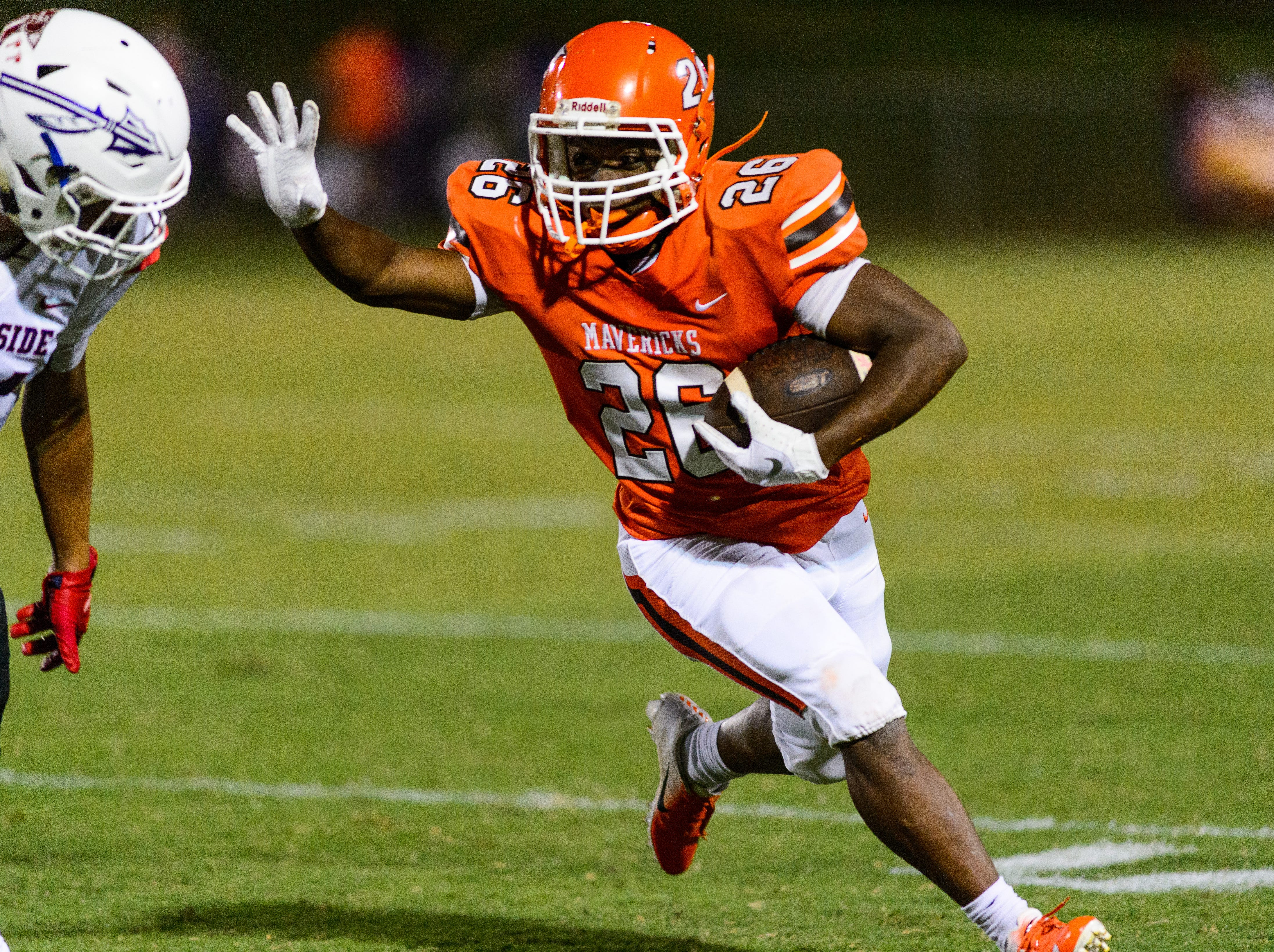 Mauldin's Jordon Franklin (26) runs to the outside and picks up a first down against Riverside on Friday, September 21, 2018, at Mauldin's Freeman Field.