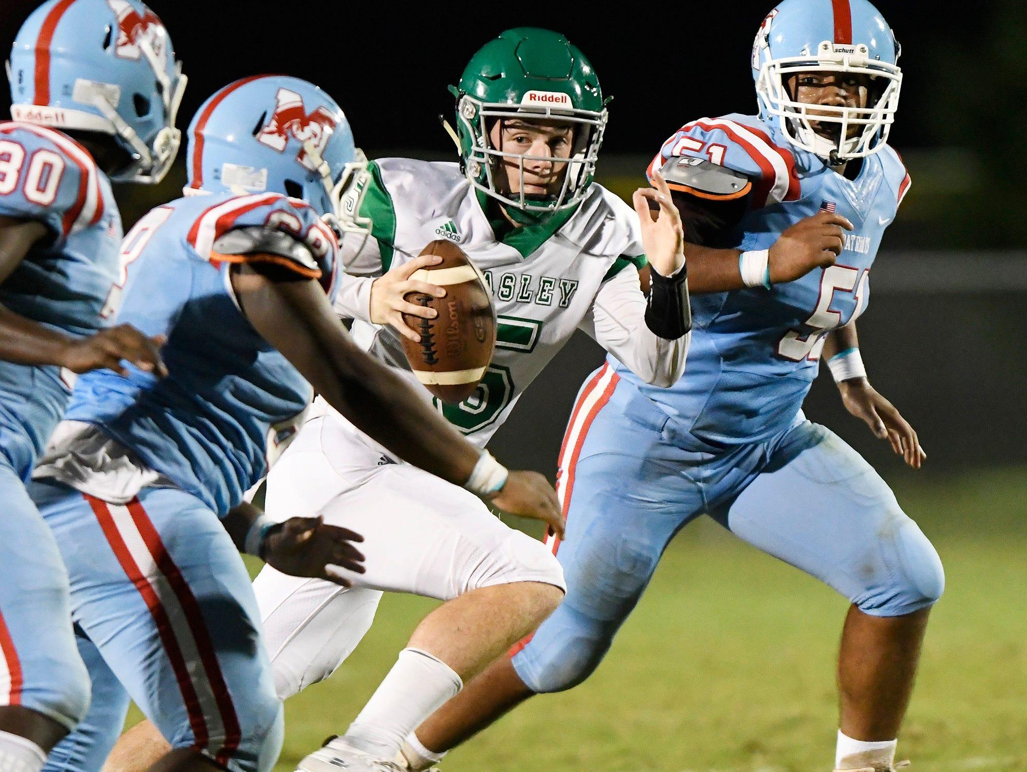 Easley quarterback Dallas Odom (5) can't escape JL Mann's defense.