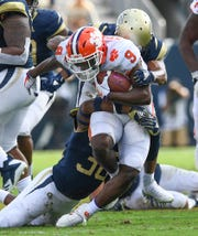 Clemson running back Travis Etienne (9) fights through the Georgia Tech defense during the 2nd quarter at Georgia Tech's Bobby Dodd Stadium Saturday, September 22, 2018.
