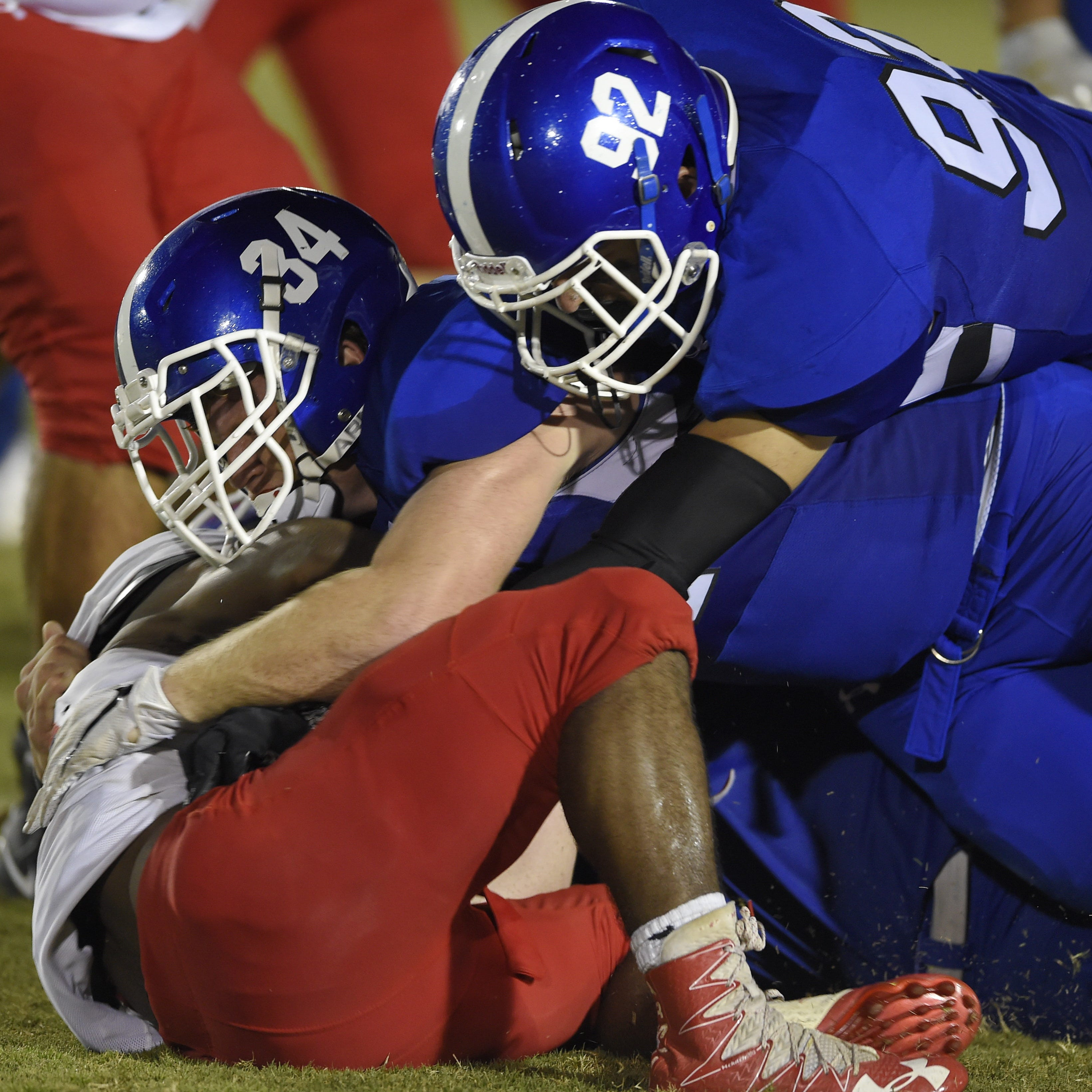 Dawson Kellett (34) and Ryan Wallace (92) lead the charge for Woodmont, which defeated Wade Hampton and has allowed one touchdown in its past two games.