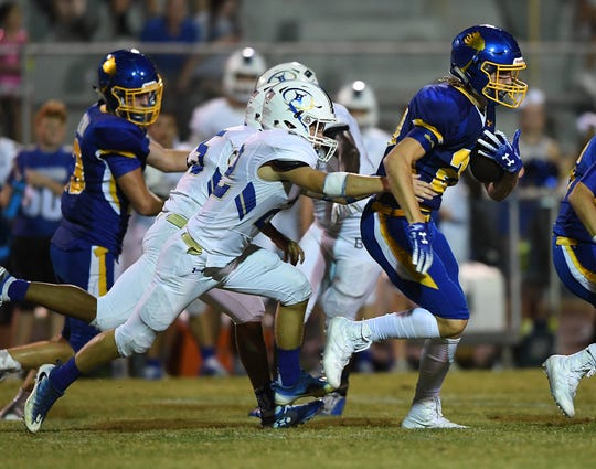 Wren's Harrison Morgan (20) carries against Broome Friday, September 21, 2018, at Wren High in Piedmont.
