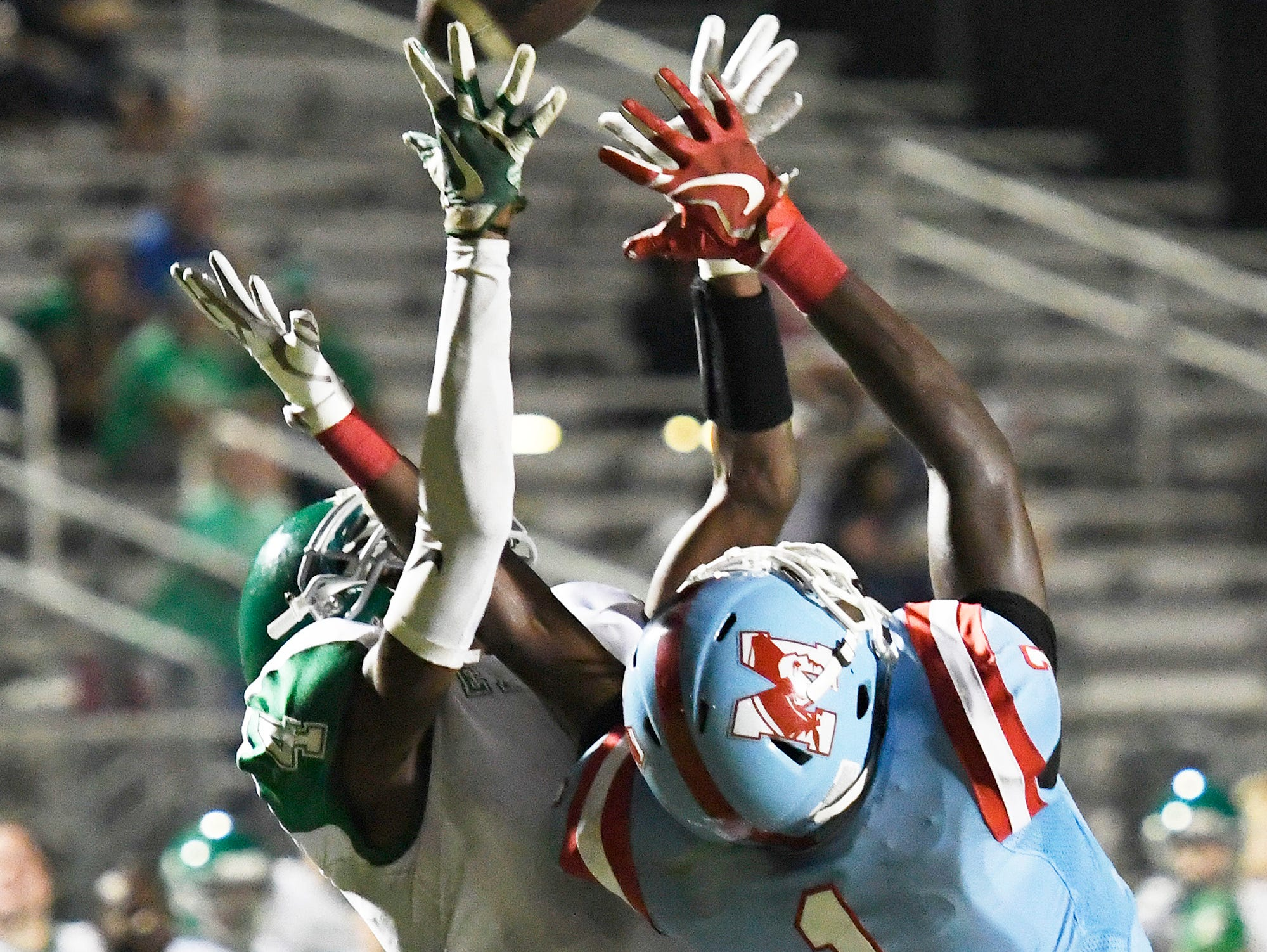Easley's Jalen Young (4) intercepts a pass intended for JL Mann's Deonte Sloan (1).