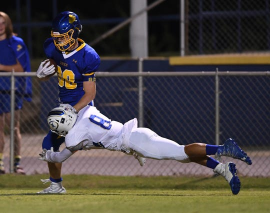 Broome's Ethan Jones (8) tries to bring down Wren's Eli Wilson (88) Friday, September 21, 2018, at Wren High in Piedmont.