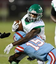 Easley's Jeremy Harried (1) is stopped by JL Mann's Kimron Lilly (15).