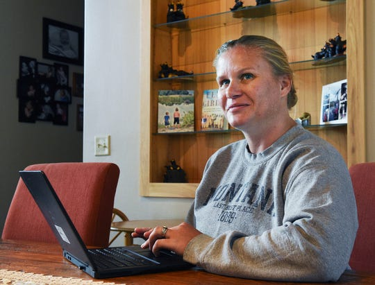 In this Monday, Sept. 17, 2018 photo, Stacey Thoft-Plimmer goes through bear cam footage on her computer at her home near St. Ignatius, Mont. Thoft-Plimmer and her family have been setting camera traps on their property to capture images and videos of the grizzly bears that wander through. Once Thoft-Plimmer started posting her greatest hits to Facebook and Youtube, she discovered a human world was equally interested. (Colter Peterson/The Missoulian via AP)