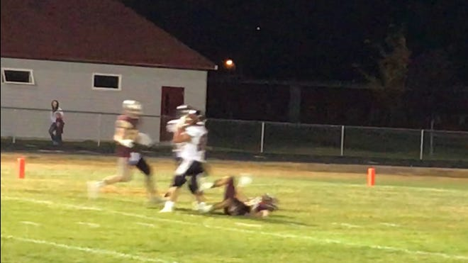 Cooper Davis (in white) catches a 33- yard touchdown pass from Carson McGinness (not pictured) for the game-winner in Centerville's come-from-behind victory at Choteau Friday night.