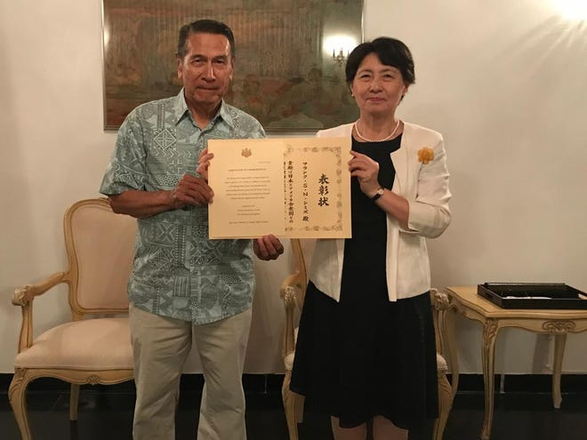 Ambros Inc. CEO Frank S.N. Shimizu on Sept. 21 received a commendation by Izumi Seki, consul-general of Japan in Hagåtña, on behalf of the Japan Ministry of Foreign Affairs.