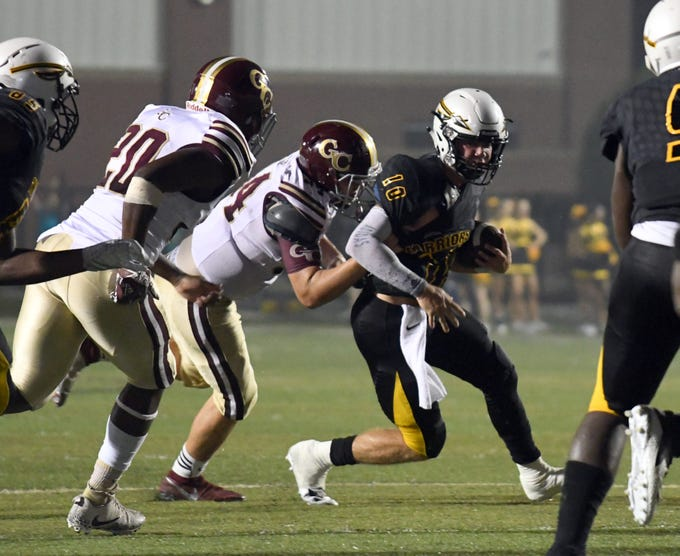 Oak Grove quarterback John Rhys Plumlee carries the ball in a game against George County in Hattiesburg on Friday, September 21, 2018.