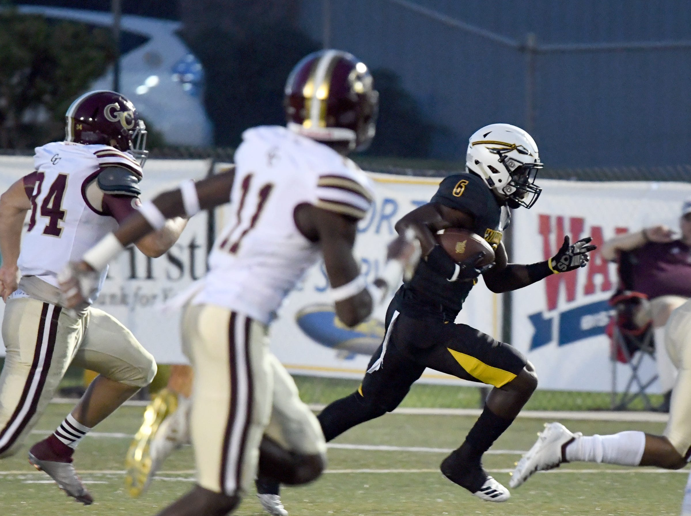 Oak Grove's Jarius Reimonenq carries the ball in a game against George County in Hattiesburg on Friday, September 21, 2018.