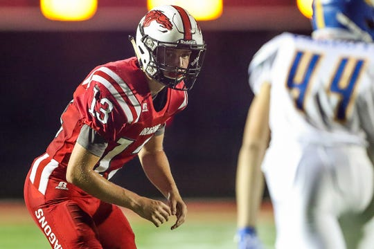 New Palestine Dragons Luke Canfield (13) works his cornerback position, defending against Greenfield-Central Cougars wide receiver Will Vanduyn (44) during the game against in New Palestine, Ind., Friday, Sept. 21, 2018.