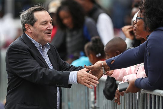 Sen. Joe Donnelly greets spectators at the Circle City Classic Parade in Indianapolis on Sept. 22.