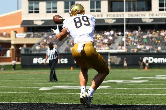Sep 22, 2018; Winston-Salem, NC, USA; Notre Dame Fighting Irish tight end Brock Wright (89) catches a pass for a touchdown in the second quarter against the Wake Forest Demon Deacons at BB&T Field. Mandatory Credit: Jeremy Brevard-USA TODAY Sports