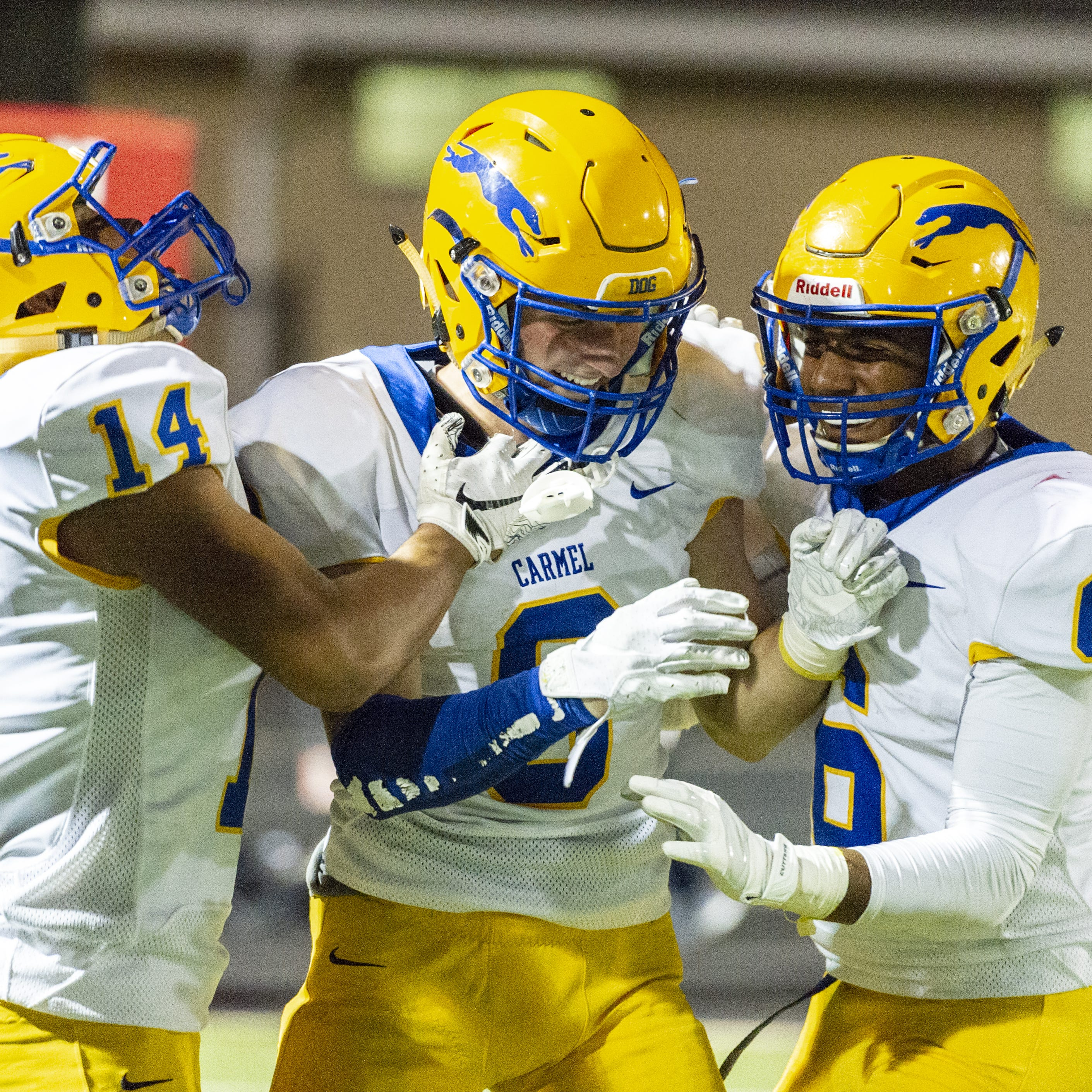 Carmel High School senior Sam Rogers (8) celebrates a touchdown in the third overtime period. North Central High School hosted Carmel High School in IHSAA varsity football action, Friday, Sept. 21, 2018. Carmel won 41-40 in three overtime periods.