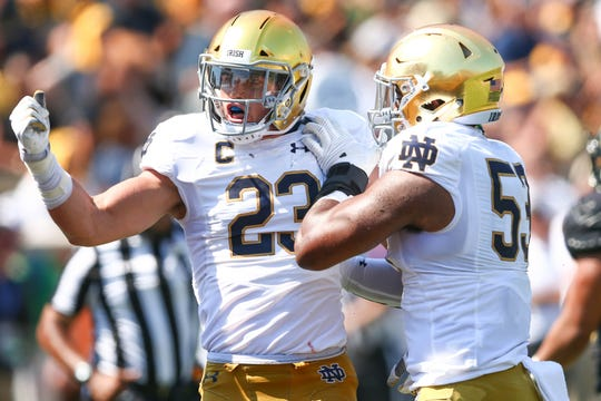 Notre Dame Fighting Irish linebacker Drue Tranquill (23) celebrates a sack in the second quarter against the Wake Forest Demon Deacons at BB&T Field.