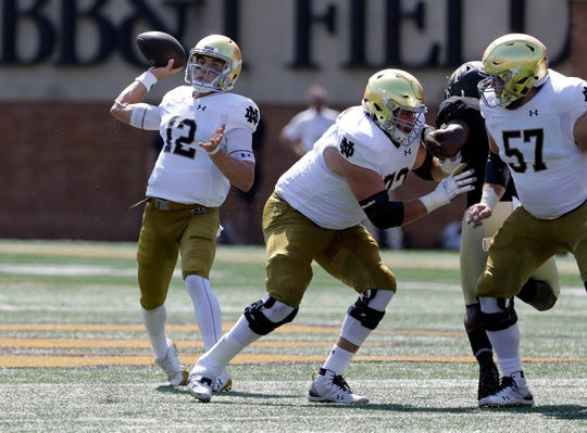 Notre Dame's Ian Book (12) looks to pass against Wake Forest in the first half of an NCAA college football game in Winston-Salem, N.C., Saturday, Sept. 22, 2018.